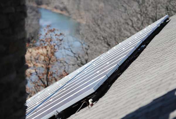 Globe/T. Rob Brown<br /> The solar panels atop Missouri State Rep. Bill White's new Joplin home overlook Shoal Creek recently. To increase solar efficiency, the panels must angle correctly in respect to the sun's position.
