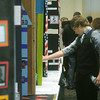 Globe/Roger Nomer<br /> Rusty Brownfield, a seventh grader at Carthage Junior High, looks at exhibits during Friday's history day at Missouri Southern.