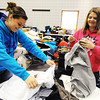 Globe/T. Rob Brown<br /> Kirsten Eden, left, and Briauna Shepherd, both 15-year-olds in the First United Methodist Church's youth group, help arrange items for the church's annual rummage sale Tuesday afternoon, March 19, 2013, which begins at 7 a.m. Wednesday.