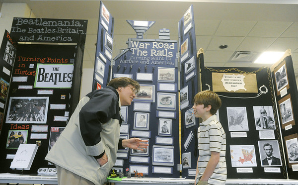 Globe/Roger Nomer<br /> Dorothy Fulks, Webb City, talks with Tyler Gray, a seventh grader at South Middle School about his project on railroads during the Civil War on Friday at Missouri Southern.