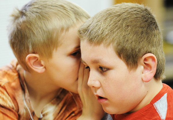 Globe/T. Rob Brown<br /> Third grader Jarred Huffaker (left) whispers into classmate Derick Burger's ear what he believes to be the answer to a question in a class game of Brain Quest Smart! game in Wendy Winter's third-grade class at McCune (Kan.) Elementary School Thursday afternoon, March 7, 2013.