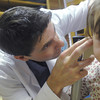 Globe/Roger Nomer<br /> Nathan Box examines Evelyn Kelley, 2, at Freeman Ear, Nose and Throat on Wednesday morning.