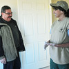Globe/Roger Nomer<br /> Homeowner Ed Kunce talks with April Foulks during a work day to paint and seal trim at the house on Feb. 6, 2013.  Foulks, a deputy juvenile officer for Jasper County, has been one of the leaders for construction and fundraising in Justice League for the Kunce's home.
