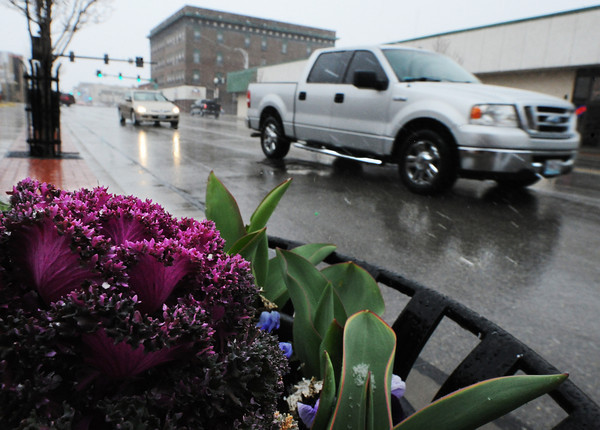 Globe/T. Rob Brown<br /> Snow and freezing drizzle fall during the first day of spring, Thursday, March 21, 2013, along Main Street in downtown Joplin.
