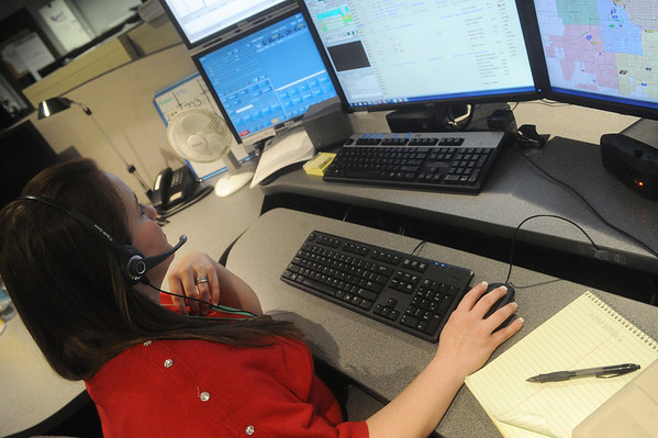 Globe/Roger Nomer<br /> Randa Connell works at the Joplin Police dispatch unit on Monday morning.