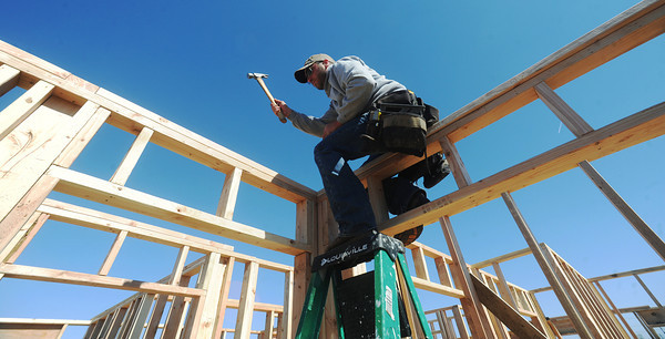 Globe/Roger Nomer<br /> Matt McGee, construction manager for Habitat for Humanity, secures walls at the 2630 Wall build site.