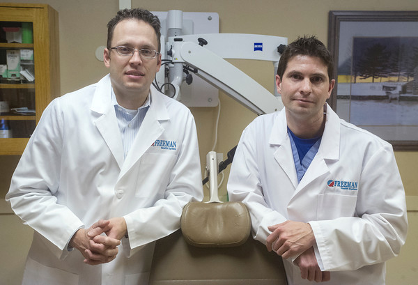 Globe/Roger Nomer<br /> Scott McClintick, left, and Nathan Box practice at Freeman Ear, Nose and Throat, and both graduated from KCUMB.