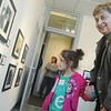 Globe/Roger Nomer<br /> Taylor Houdyshell, 5, and her grandmother Mary Ellen Walker, Joplin, take a look at the photos in the PhotoSpiva Kids show during Sunday's reception.