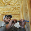 Globe/Roger Nomer<br /> Eric Jeffries installs plumbing at the Habitat for Humanity home at 2630 Wall.  Several specialists helped complete the home as well as worked to make it more energy efficient.