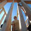 Globe/Roger Nomer<br /> Andrew Doennig, a juvenile officer in Jasper County, makes sure a wall is level during the first day of the habitat build.