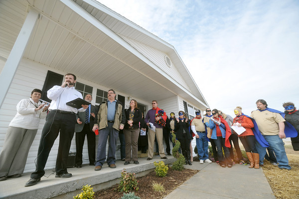 Globe/Roger Nomer<br /> Habitat for Humanity and Justice League members gather for the dedication of 2630 Wall on March 13, 2013.