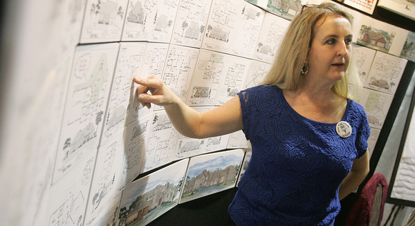 Globe/Roger Nomer<br /> Connie Baker talks about floorplans at the B and G Drafting booth at Friday's Home Builders Show at the Holiday Inn Convention Center.