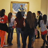 """Globe/Roger Nomer<br /> A school group examines Norman Rockwell's """"Rosie the Riveter"""" during a tour at Crystal Bridges Art Museum on Thursday."""