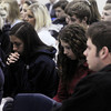Globe/Roger Nomer<br /> McAuley High students pray during an assembly on Tuesday morning.