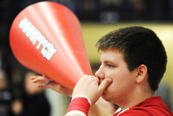 Globe/T. Rob Brown<br /> Carl Junction High School senior Nic Gildhouse uses a megaphone to pump up the crowd, as part of Carl Junction Coed Cheer, Saturday afternoon, March 2, 2013, during the District 12 Class 4 Basketball Tournament in Carthage High School's gymnasium. Carl Junction ended up coming back to tie it up with Carthage, sending the game into overtime before taking a 5-point lead and winning.