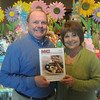 Globe/Roger Nomer<br /> Terry and Pat Hicklin pose with the cover of Manufacturing Confectioner magazine featuring the Candy House.