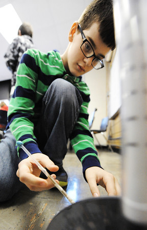 Globe/T. Rob Brown<br /> Sixth grader Nathan Campbell adjusts the angle of trajectory for his classmade air-powered rocket in Sandra Martinie's sixth-grade science class at McCune (Kan.) Elementary School Thursday afternoon, March 7, 2013.