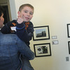 Globe/Roger Nomer<br /> Gavin Box, 6, points out photos to his mother Jillian, Joplin, during the opening of the PhotoSpiva Kids exhibit on Sunday.