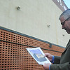 Globe/Roger Nomer<br /> Paul Whitehill looks at his plans for a Route 66 themed mural at Seventh and Joplin on Monday afternoon.