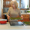 Globe/Roger Nomer<br /> Becky Mitchell prepares a batch of Cheddar Kale Chips on Tuesday morning.