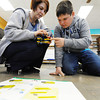 Globe/T. Rob Brown<br /> Sixth-grade teacher Sandra Martinie assists her student Nathan Campbell as he works on a motorized LEGO project during science class at McCune (Kan.) Elementary School Thursday afternoon, March 7, 2013.