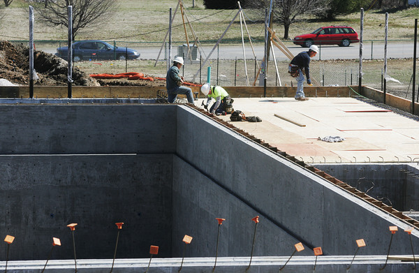 Globe/Roger Nomer<br /> Construction continues on the deep end and deck of Schifferdecker Pool on Tuesday afternoon.