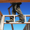Globe/Roger Nomer<br /> A volunteer walks along the top of the walls at the 2630 Wall build site.