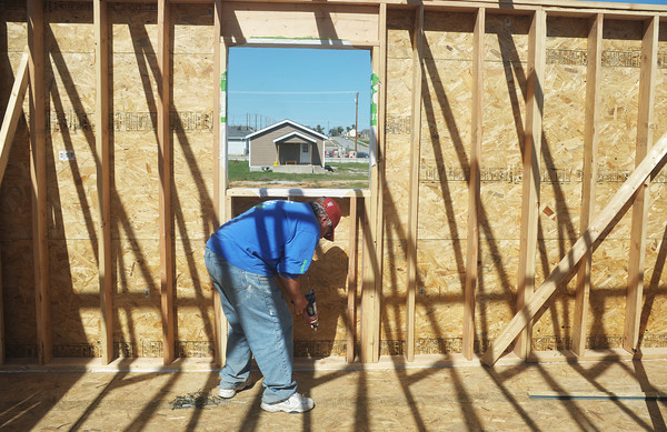Globe/Roger Nomer<br /> Norm Clearfield, of Chicago, works on a wall during a Thrivent Builds workday in October at 2630 Wall.  Clearfield has traveled the world in the past 10 years helping with construction projects as part of Thrivent Builds.