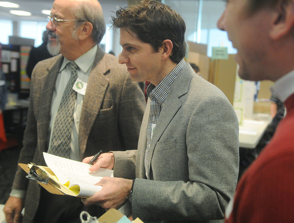 Globe/Roger Nomer<br /> Nathan Box, center, judges science exhibits at the Missouri Southern Regional Science Fair with Jim Jackson, left, and Brendon Bailey on Tuesday.