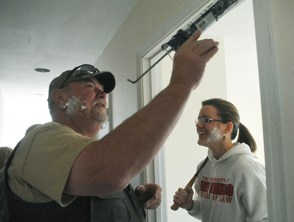 Globe/Roger Nomer<br /> John Williams, also known as Iceman, and Katrina Richards, bear the marks of a caulk fight during a work day at 2630 Wall in February.