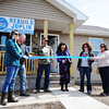 Globe/T. Rob Brown<br /> Susie Lamar cuts the ribbon to her and her husband Wes Lamar's new home Tuesday afternoon, March 19, 2013. The Lamars lost their home in the 2011 tornado and Rebuild Joplin has helped them return.