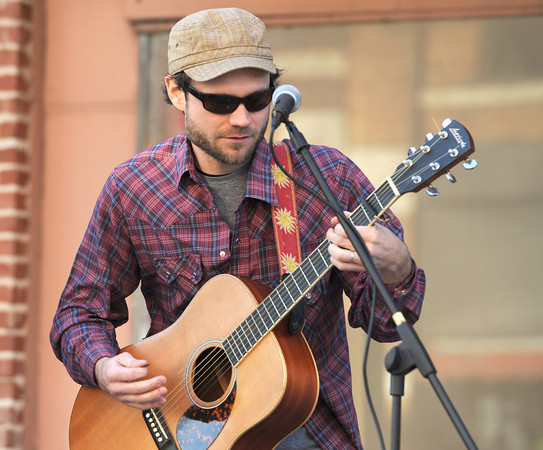 Josh Jennings entertains the crowd as he performs with Bob Alexander on Thursday night for the first Third Thursday of the season. <br /> Globe | Laurie Sisk