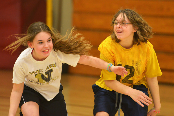 Globe/Roger Nomer<br /> Ashley Ray, 12, left, a unified player, and Makayla Slawter, 17, compete for positiion during practice for the Special Olympics basketball team on Tuesday at Neosho Junior High School.