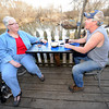 Sue Burrack, left and Dennis Robbins enjoy some conversation on the deck at The River's Bend on Shoal Creek near Reddings Mill. Robbins grandfather was a second cousin to country legend Marty Robbins and Dennis said he enjoys the live jam sessions at the bar and grill.<br /> Globe | Laurie Sisk