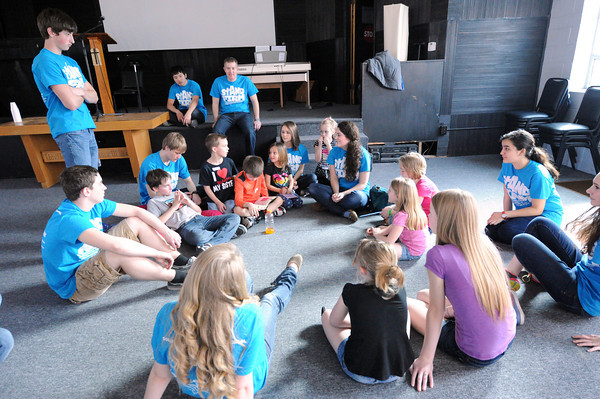 College Heights Christian School students discuss the Biblibal story of David and Goliath during the afterschool program on Tuesday at Life House. The activity is part of their Missions Week at College Heights.<br /> Globe | Laurie Sisk