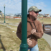 Globe/Roger Nomer<br /> John Graham, with the Joplin Parks and Rec Department, helps rewire park lamps at Cunningham Park on Wednesday.