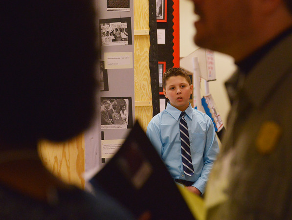 Globe/Roger Nomer<br /> Holden Ledford, a sixth grader at Joplin South Middle School, keeps a nervous eye on the judges as they approach his presentation at History Day at Missouri Southern on Friday.