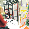 Ten-year-old Izzy Baldwin, of Fairview Elementary in Carthage, looks over a science project at the Missouri Southern State University Science Fair on Tuesday at Billingsley Student Center. The project, completed by Joplin South Middle School students Britney Free and Hera Schneider, sought to determine if dice manucatured by different companies had the same probability of rolling a six.<br /> Globe | Laurie Sisk
