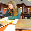 Savannah Schwab researches her grandfather's military history on Thursday at Missouri Southern State University's Spiva Library. Her grandfather, Donald K. Schwab, a World War II veteran, is being posthumously awarded a Medal of Honor.<br /> Globe | Laurie Sisk