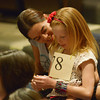 Globe/Roger Nomer<br /> Amanda Chavez congratulates her daughter Annabel Meredith, a fourth grader at West Central Elementary, after she was knocked out of the bee on Monday.