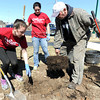 "Rick Friend, right, of the Joplin Parks and Recreation Department, helps George Washington University students Kat Rodrigues, left and Chelsea Willoughby plant a Black Tupelo tree in Cunningham Park on Monday. The GW students were on an ""alternative spring break,"" helping plant 161 trees in the park to memorialize lives lost in the May, 2011 tornado. The tree planting is part of a program called ""Growing Trees Together"" and is being administered by the U.S. Forestry Department, Missouri Conservation Department and the cities of Joplin and Duquesne.<br /> Globe 