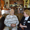 Globe/Roger Nomer<br /> Don Atteberry talks with Jackie Meneses, his case manager from Catholic Charities, in his rebuilt house near 23rd and Pennsylvania on Tuesday afternoon. After his home of 50 years was destroyed by the 2011 tornado, Catholic Charities helped rebuild Atteberry's house to nearly the same design of his previous one. Catholic Charities is one of several organizations to use donated tornado funds to help rebuild homes.