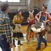 Globe/Roger Nomer<br /> (from left) Stefan Barner, Ashley Cutright, Elizabeth Fischborn and Tim Petty tell the story of two smart bunnies facing off against two wiley coyotes during a visit by the Tulsa Opera to St. Mary's Elementary on Thursday.