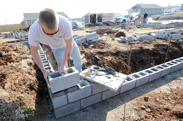 Tyson Schneider, of Greenville, NC, helps build the foundation for a new home at 2401 South Murphy on Thursday. Schneider is a volunteer for Christian Public Service , which is working in conjunction with Rebuild Joplin to build the home.<br /> Globe | Laurie Sisk