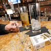 A customer, who chose to remain anonymous, sits at the bar at Club 609, holds a cigarette and lighter as she enjoys a drink at the establishment. The restaurant and bar recently opted to establish a non-smoking policy during dining hours.<br /> Globe | Laurie Sisk