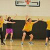 Globe/Roger Nomer <br /> (from left) LaShayla Gillespie, 18, Dominique Dechant, 19, Azalea Ray, 15, and Makayla Slawter, 17, get into defensive position during a practice for the Special Olympics basketball team at Neosho Junior High on Tuesday.
