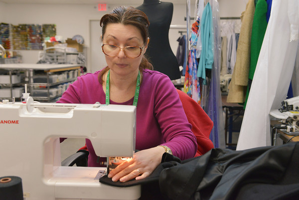 Globe/Roger Nomer<br /> Ukraine native Liliya Moos stitches a coat at Adornables on Monday morning.