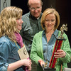 Globe/Roger Nomer<br /> Lainey Moran, a sixth grader at St. Peter's Middle School, shows her runner-up trophy to her parents Matt and Annette Moran following Monday's spelling bee.