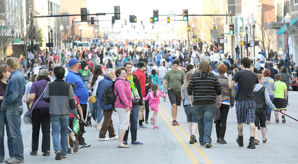 A large crowd gathers early on Thursday night for the first Third Thursday of the season. The event is entering its seventh year and is sponsored by the Joplin Convention and Visitors Bureau and the Downtown Joplin Alliance.<br /> Globe | Laurie Sisk