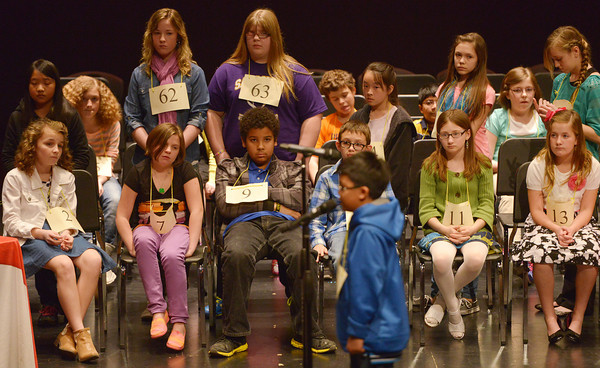 Globe/Roger Nomer<br /> The group of remaining spellers in a later round watch a student recite a word during Monday's spelling bee.